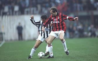 1 Apr 1995:  Robertio Baggio (left) of Juventus takes on Franco Baresi (right) of AC Milan during a Serie A match at the San Siro Stadium in Milan, Italy. Juventus won the match 2-0.  \ Mandatory Credit: Allsport UK /Allsport