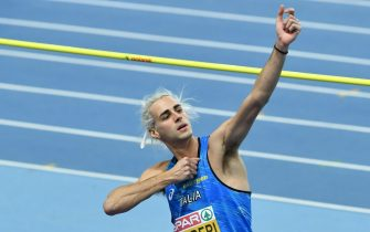 epa09059299 Gianmarco Tamberi of Italy reacts during the men's High Jump competition at the 36th European Athletics Indoor Championships in Torun, north-central Poland, 07 March 2021.  EPA/ADAM WARZAWA POLAND OUT