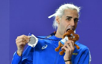 epa09059033 Silver medalist Gianmarco Tamberi of Italy poses for a photo during the medal ceremony of the men's High Jump competition competition at the 36th European Athletics Indoor Championships in Torun, north-central Poland, 07 March 2021.  EPA/ADAM WARZAWA POLAND OUT