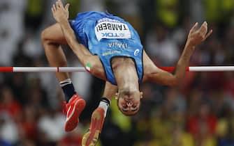 epa07895812 Gianmarco Tamberi of Italy  competes in the men's High Jump final during the IAAF World Athletics Championships 2019 at the Khalifa Stadium in Doha, Qatar, 04 October 2019. EPA/VALDRIN XHEMAJ