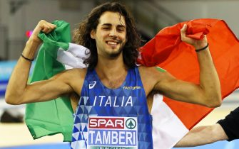 epa07409484 Gianmarco Tamberi of Italy celebrates after winning the gold medal in the men's High Jump final at the 35th European Athletics Indoor Championships in Glasgow, Britain, 02 March 2019.  EPA/VALDRIN XHEMAJ