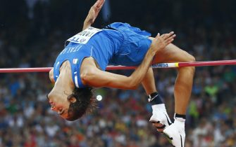 epa04905042 Italy's Gianmarco Tamberi competes in the men's High Jump final during the Beijing 2015 IAAF World Championships at the National Stadium, also known as Bird's Nest, in Beijing, China, 30 August 2015.  EPA/DIEGO AZUBEL