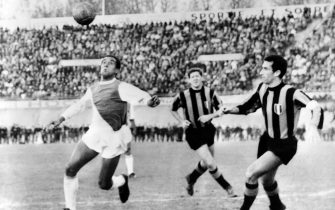 French footballer Lucien Cossou of AS Monaco fights for the ball against the players of the Internazionale at the Stade Vélodrom, on December 4, 1963 in Marseille during the 196263 European Cup. Inter Milan qualified for the Quarter-finals. (Photo by - / AFP) (Photo by -/AFP via Getty Images)