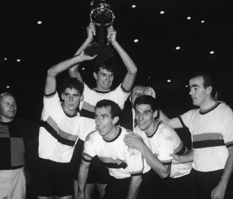 Armando Picchi, captain of the Internazionale or Inter football team, celebrates his team's win in the World Club Championship at the Santiago Bernabeu Stadium in Madrid, 26th September 1964. Holding the cup is teammate Giacinto Facchetti. (Photo by Hulton Archive/Getty Images)