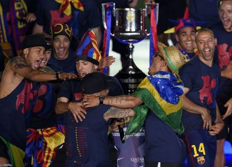 Barcelona players react as they take part in the celebrations held for their victory over Juventus, one day after the UEFA Champions League final football, at the Camp Nou stadium in Barcelona on June 7, 2015. Luis Suarez and Neymar scored second-half goals to give Barcelona a 3-1 Champions League final victory over Juventus on June 6, 2015 as the Spaniards became the first team to twice win the European treble. AFP PHOTO/ LLUIS GENE        (Photo credit should read LLUIS GENE/AFP via Getty Images)