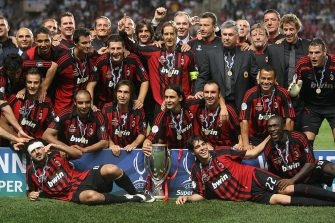 Milan's football players celebrate with their trophy after winning the european Super Cup football match Sevilla vs Milan AC, 31 August 2007 at the Louis II stadium in Monaco. Milan won 3-1. AFP PHOTO  VALERY HACHE (Photo credit should read VALERY HACHE/AFP via Getty Images)