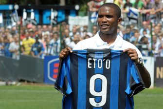 Cameroon striker Samuel Eto'o poses with his new jersey at Inter Milan training centre in Appiano Gentile on July 28, 2009 .  He is part of a swap deal that will see Sweden forward Zlatan Ibrahimovic head to Catalonia while Inter will also pocket 50 million euros and take Belarus winger Alexander Hleb on loan for a year.  AFP PHOTO / GIUSEPPE CACACE (Photo credit should read GIUSEPPE CACACE/AFP via Getty Images)