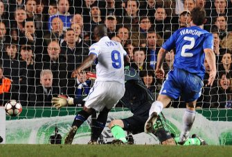 Inter Milan's Cameroonian forward Samuel Eto'o (C) scores past Chelsea's goalkeeper Ross Turnbull (C) as Chelsea's defender Branislav Ivanovic (R) looks on during their second leg in the round of 16 UEFA Champions League match at home to Chelsea at Stamford Bridge football stadium, London on March 16, 2010. The match ended 1-0 to Inter Milan. AFP PHOTO/Carl de Souza (Photo credit should read CARL DE SOUZA/AFP via Getty Images)
