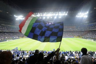 Inter Milan's  supporters celebrate at San Siro stadium in Milan after their team's victory against Bayern Munich in the UEFA Champions league final football match on May 23, 2010.  Inter beat Bayern Munich 2-0 to add the European title to their Serie A and domestic cup triumphs allowing Inter Milan's Portuguese coach Jose Mourinho to become just the third coach to win the continental crown with two different teams.    AFP PHOTO DAMIEN MEYER (Photo credit should read DAMIEN MEYER/AFP via Getty Images)
