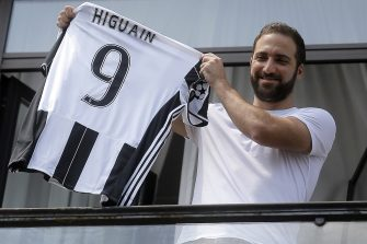 Juventus' forward Gonzalo Higuain from Argentina holds his jersey at the Juventus' headquarter in Turin on July 27, 2016. Gonzalo Higuain completed a sensational move to Juventus after the Italian champions agreed to pay a 90 million euros ($98.8m) fee, the third highest in history, to wrest the Argentine striker from Napoli on July 26. In what is the biggest ever transfer fee recorded between two Serie A clubs, Higuain's move to Turin on a five-year deal was confirmed by Juventus two hours after being published by Serie A league bosses on their official website.  / AFP / MARCO BERTORELLO        (Photo credit should read MARCO BERTORELLO/AFP via Getty Images)