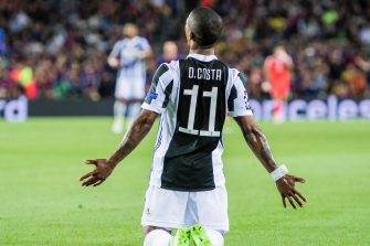BARCELONA, SPAIN - SEPTEMBER 12: Douglas Costa of Juventus reacts during the UEFA Champions League 2017-18 match between FC Barcelona and Juventus at Camp Nou on 12 September 2017 in Barcelona, Spain. (Photo by Power Sport Images/Getty Images)