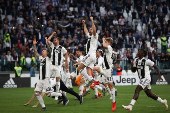 """(From L) Juventus' Italian forward Federico Bernardeschi, Juventus' Bosnian midfielder Miralem Pjanic, Juventus' Italian defender Andrea Barzagli, Juventus' Italian midfielder Hans Nicolussi Caviglia and Juventus' Italian forward Moise Kean acknowledge fans and celebrate after Juventus secured its 8th consecutive Italian 2018/19 """"Scudetto"""" Serie A championships, after winning the Italian Serie A football match Juventus vs Fiorentina on April 20, 2019 at the Juventus stadium in Turin. (Photo by Isabella BONOTTO / AFP)        (Photo credit should read ISABELLA BONOTTO/AFP via Getty Images)"""