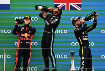NUERBURG, GERMANY - OCTOBER 11: Race winner Lewis Hamilton of Great Britain and Mercedes GP, second placed Max Verstappen of Netherlands and Red Bull Racing and third placed Daniel Ricciardo of Australia and Renault Sport F1 celebrate on the podium during the F1 Eifel Grand Prix at Nuerburgring on October 11, 2020 in Nuerburg, Germany. (Photo by Ina Fassbender - Pool/Getty Images)