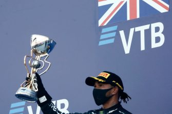 Third placed Mercedes' British driver Lewis Hamilton celebrates on the podium after the Formula One Russian Grand Prix at the Sochi Autodrom Circuit in Sochi on September 27, 2020. (Photo by MAXIM SHEMETOV / POOL / AFP) (Photo by MAXIM SHEMETOV/POOL/AFP via Getty Images)