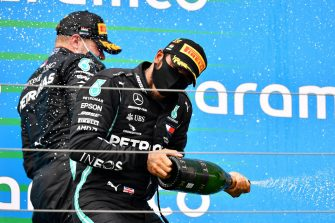 BUDAPEST, HUNGARY - JULY 19: Race winner Lewis Hamilton of Great Britain and Mercedes GP celebrates on the podium after the Formula One Grand Prix of Hungary at Hungaroring on July 19, 2020 in Budapest, Hungary. (Photo by Joe Klamar/Pool via Getty Images)