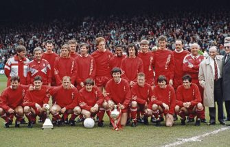 LIVERPOOL, ENGLAND - MAY 02:  The Liverpool team are pictured after being crowned League Champions before the Barclays League Division One match against Southampton at Anfield in Liverpool, England, United Kingdom, Back Row left to right, Player/Manager Kenny Dalglish, Roy Evans, Kevin MacDonald, Barry Venison, Jan Molby, Ronnie Whelan, Mike Hooper, John Barnes, Craig Johnston, Nigel Spackman, Gary Gilespie, Bruce Grobbelaar, Ronnie Moran, Front Row, Jim Beglin, John Aldridge, Steve McMahon, Peter Beardsley, Alan Hansen with trophy, Steve Nicol, Ray Houghton and Gary Ablett.   (Photo by Simon Bruty/Allsport/Getty Images/Hulton Archive)