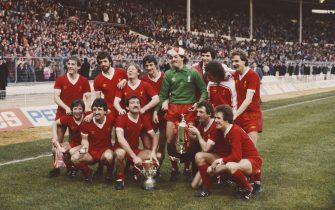 LONDON, UNITED KINGDOM - MARCH 13: The victorious Liverpool team pose after their 3-1 victory over Tottenham Hotspur to win the 1982 Milk Cup Final at Wembley Stadium on March 13, 1982 in London, England, back row from left to right, Kenny Dalglish, Mark Lawrenson, Sammy Lee, Ian Rush, Bruce Grobbelaar, Alan Hansen, Terry McDermott and Phil Thompson, front row, Ronnie Whelan, David Johnson, Graeme Souness, Alan Kennedy and Phil Neal. (Photo by Tony Duffy/Allsport/Getty Images)