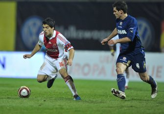 Dinamo Zagreb's Dejan Lovren (R) fights for the ball with Ajax's Luis Suarez their UEFA LEAGUE Group A match between Dinamo Zagreb and Ajax in Maksimir stadium in Zagreb on November 5, 2009. AFP PHOTO/ STRINGER (Photo credit should read STRINGER/AFP via Getty Images)