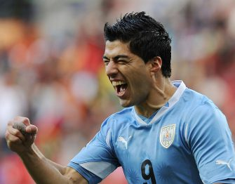 Uruguay's striker Luis Suarez celebrates after scoring the opening goal during the 2010 World Cup round of 16 football match between Uruguay and South Korea on June 26, 2010 at Nelson Mandela Bay Stadium in Port Elizabeth. NO PUSH TO MOBILE / MOBILE USE SOLELY WITHIN EDITORIAL ARTICLE - AFP PHOTO / JUNG YEON-JE (Photo credit should read JUNG YEON-JE/AFP via Getty Images)