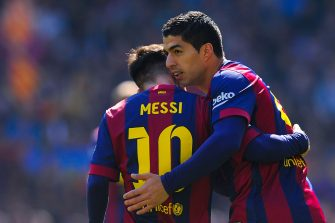 BARCELONA, SPAIN - MARCH 08:  Luis Suarez (R) of FC Barcelona celebrates with his teammate Lionel Messi of FC Barcelona after scoring the opening goal during the La Liga match between FC Barcelona and Rayo Vallecano de Madrid at Camp Nou on March 8, 2015 in Barcelona, Spain.  (Photo by David Ramos/Getty Images)
