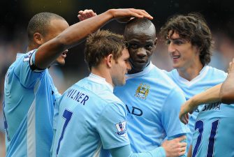 MANCHESTER, ENGLAND - SEPTEMBER 24:  James Milner of Manchester City celebrates scoring to make it 2-0 with team mate Mario Balotelli during the Barclays Premier League match between Manchester City and Everton at the Etihad Stadium on September 24, 2011 in Manchester, England.  (Photo by Michael Regan/Getty Images)