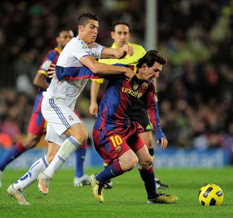 "Barcelona's Argentinian forward Lionel Messi (R) vies for the ball with Real Madrid's Portuguese forward Cristiano Ronaldo during the Spanish league ""clasico"" football match FC Barcelona vs Real Madrid on November 29, 2010 at Camp Nou stadium in Barcelona. Barcelona won 5-0.   AFP PHOTO/ JOSEP LAGO (Photo credit should read JOSEP LAGO/AFP via Getty Images)"