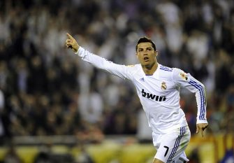 Real Madrid's Portuguese forward Cristiano Ronaldo celebrates after scoring during the Spanish Cup final match Real Madrid against Barcelona at the Mestalla stadium in Valencia on April 20, 2011.   AFP PHOTO / PIERRE-PHILIPPE MARCOU (Photo credit should read PIERRE-PHILIPPE MARCOU/AFP via Getty Images)