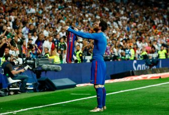 Barcelona's Argentinian forward Lionel Messi celebrates after scoring during the Spanish league Clasico football match Real Madrid CF vs FC Barcelona at the Santiago Bernabeu stadium in Madrid on April 23, 2017. / AFP PHOTO / OSCAR DEL POZO        (Photo credit should read OSCAR DEL POZO/AFP via Getty Images)