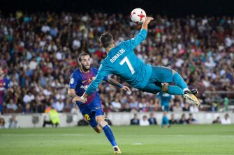 BARCELONA, SPAIN - AUGUST 13: Cristiano Ronaldo of Real Madrid (R) attempts a bicycle kick during the Supercopa de Espana Final 1st Leg match between FC Barcelona and Real Madrid at Camp Nou on August 13, 2017 in Barcelona, Spain. (Photo by Marcio Rodrigo Machado/Power Sport Images/Getty Images,)