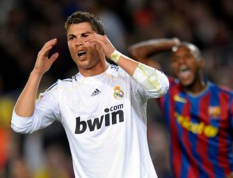 Real Madrid's Portuguese forward Cristiano Ronaldo reacts during their Spanish League football match between Barcelona and Real Madrid on November 29, 2009 at Camp Nou stadium in Barcelona. AFP PHOTO/LLUIS GENE. (Photo credit should read LLUIS GENE/AFP via Getty Images)