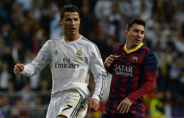 "Real Madrid's Portuguese forward Cristiano Ronaldo (L) and Barcelona's Argentinian forward Lionel Messi look on during the Spanish league ""Clasico"" football match Real Madrid CF vs FC Barcelona at the Santiago Bernabeu stadium in Madrid on March 23, 2014.   AFP PHOTO/ GERARD JULIEN        (Photo credit should read GERARD JULIEN/AFP via Getty Images)"