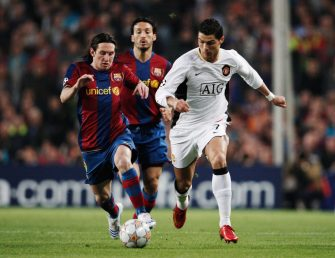 BARCELONA, SPAIN - APRIL 23:  Cristiano Ronaldo (R) of Manchester United holds off the challenge of Lionel Messi (L) of Barcelona during the UEFA Champions League Semi-Final, first leg match between Barcelona and Manchester United at the Camp Nou stadium on April 23, 2008 in Barcelona, Spain.  (Photo by Jasper Juinen/Getty Images)