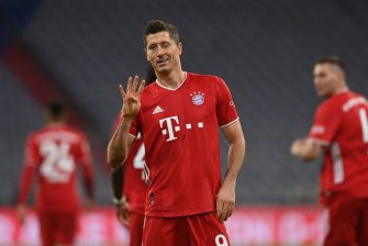 TOPSHOT - Bayern Munich's Polish forward Robert Lewandowski celebrates scoring from the penalty spot his team's forth goal to lead and win 4:3 during the German first division Bundesliga football match FC Bayern Munich vs Hertha Berlin on October 4, 2020 in Munich, southern Germany. (Photo by CHRISTOF STACHE / AFP) / DFL REGULATIONS PROHIBIT ANY USE OF PHOTOGRAPHS AS IMAGE SEQUENCES AND/OR QUASI-VIDEO (Photo by CHRISTOF STACHE/AFP via Getty Images)