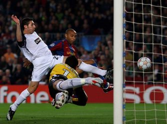 BARCELONA, SPAIN - NOVEMBER 07:  Thierry Henry of Barcelona scores as Carlos Cuellar of Rangers tries to challenge during the UEFA Champions League Group E match between Barcelona and Rangers at the Camp Nou Stadium on November 7, 2007 in Barcelona, Spain.  (Photo by Shaun Botterill/Getty Images)