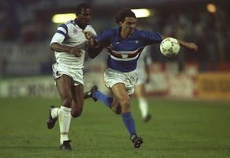 9 May 1990:  Roberto Mancini (right) of Sampdoria holds off Stephen Keshi (left #4) of Anderlecht during the European Cup Winners Cup Final match in Gothenburg, Sweden. Sampdoria won the match 2-0. \ Mandatory Credit: Ben  Radford/Allsport