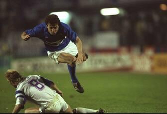 9 May 1990:  Amedeo Carboni (right) of Sampdoria flies over Arnor Gudjohnson (left) of Anderlecht during the European Cup Winners Cup Final match in Gothenburg, Sweden. Sampdoria won the match 2-0.   \ Mandatory Credit: Ben  Radford/Allsport