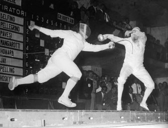 Giuseppe Delfino of Italy scores a winning hit on Allen Jay of Great Britain to take the gold in the Men's Individual Epee at the Rome Olympics, 1960 (Photo by Keystone/Hulton Archive/Getty Images)