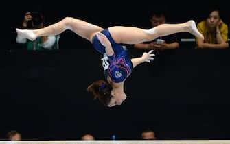epa03899633 Italy's Vanessa Ferrari performs on the balance beam during the Artistic Gymnastics World Championships in Antwerp, Belgium, 06 October 2013.  EPA/MARIJAN MURAT EDITORIAL USE ONLY