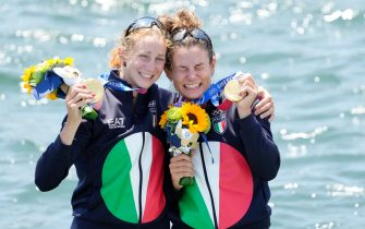 epa09375250 Gold medalists Valentina Rodini (L) and Federica Cesarini of Italy during the medal ceremony for the Lightweight Women's Double Sculls final during the Rowing events of the Tokyo 2020 Olympic Games at the Sea Forest Waterway in Tokyo, Japan, 29 July 2021.  EPA/FRANCK ROBICHON
