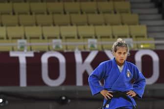 Italian Odette Giuffrida (blue) fights against Japanese Abe Uta during their semi-final Judo 52 kg at the Nippon Budokan arena in Tokyo, Japan, 25 July 2021. Abe Uta won the match.   ANSA / CIRO FUSCO