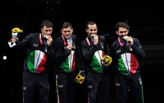 (from L) Luigi Samele, Aldo Montano, Luca Curatoli, and Enrico Berrè celebrate their silver medal in the men's sabre team during the Tokyo 2020 Olympic Games at the Makuhari Messe Hall in Chiba, Japan, 28 July 2021. ANSA / CIRO FUSCO