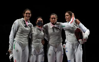 epa09376418 Italy team selebrate after wining against the team of USA of the Fencing Women'a Foil team Bronze medal match of the Tokyo 2020 Olympic Ga?mes at the Makuhari Messe convention centre in Chiba, Japan, 29 July 2021.  EPA/DIEGO AZUBEL