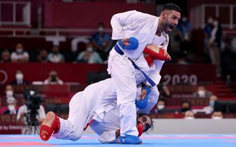 TOKYO, JAPAN - AUGUST 06: Luigi Busa (R) of Team Italy competes against Rafael Aghayev of Team Azerbaijan during the Men's Karate Kumite -75kg Gold Medal Bout on day fourteen of the Tokyo 2020 Olympic Games at Nippon Budokan on August 06, 2021 in Tokyo, Japan. (Photo by Harry How/Getty Images)