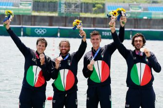 epa09372024 (from left) Matteo Castaldo, Marco di Costanzo, Matteo Lodo and Giuseppe Vicino of Italy celebrate after winning bronze in the Men's Four final at the Rowing events of the Tokyo 2020 Olympic Games at the Sea Forest Waterway in Tokyo, Japan, 28 July 2021.  EPA/KIMIMASA MAYAMA