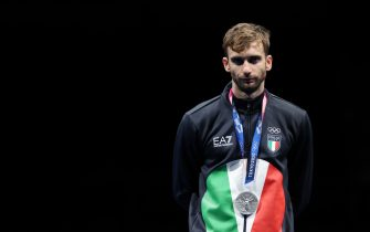 26 July 2021, Japan, Chiba: Fencing: Olympics, foil singles, finals, men, at Makuhari Messe Hall B. Daniele Garozzo of Italy with silver medal at the award ceremony. Photo: Oliver Weiken/dpa (Photo by Oliver Weiken/picture alliance via Getty Images)