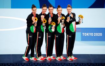 epa09405262 Bronze medalists Team Italy during the medal ceremony for the rhythmic gymnastics group all-around final during the Tokyo 2020 Olympic Games at the Tokyo Metropolitan Gymnasium arena in Tokyo, Japan, 08 August 2021.  EPA/TATYANA ZENKOVICH