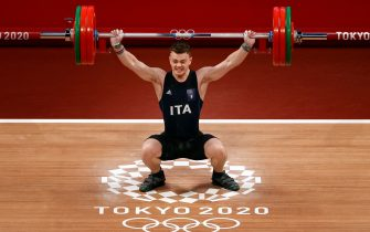 epa09364933 Mirko Zanni of Italy competes for the Men's 67 kg Santch Weightlifting event of the Tokyo 2020 Olympic Games at the Tokyo International Forum in Tokyo, Japan, 25 July 2021.  EPA/RITCHIE B. TONGO