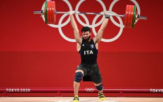 Italy's Antonino Pizzolato competes in the men's 81kg weightlifting competition during the Tokyo 2020 Olympic Games at the Tokyo International Forum in Tokyo on July 31, 2021. (Photo by Luis ACOSTA / AFP) (Photo by LUIS ACOSTA/AFP via Getty Images)