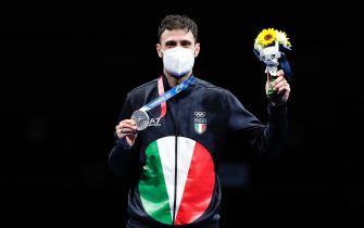 epa09362282 Silver medalist Luigi Samele of Italy celebrates on the podium during a victory ceremony of the men's Sabre individual event during the Fencing events of the Tokyo 2020 Olympic Games at the Makuhari Messe convention centre in Chiba, Japan, 24 July 2021.  EPA/KIYOSHI OTA