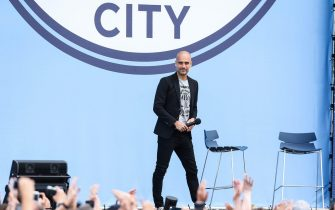 epa05405863 Manchester City manager Pep Guardiola is unveiled to fans at the Etihad Stadium, Manchester, Britain, 03 July 2016.  EPA/PA UK AND IRELAND OUT